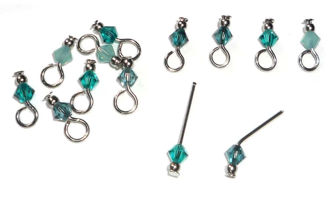 Mit Swarovski Perlen selbstgemachte kleine Schmuckanhänger