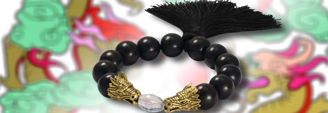 Hozperlen Armband mit Drachenköpfen und großer Quaste